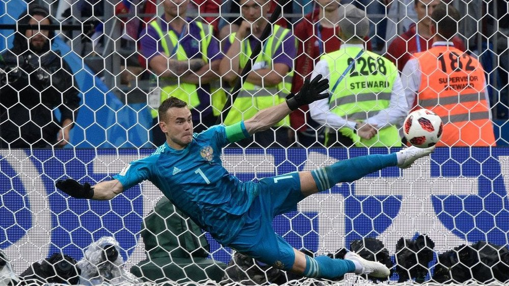 Russia's Igor Akinfeev making that all important denial (Source: AFP)