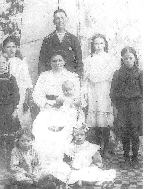My great-great-grandmother, Annie Eugenie Stiff seated in chair, my great-grandmother, Doris, seated on the floor to the right, date unknown