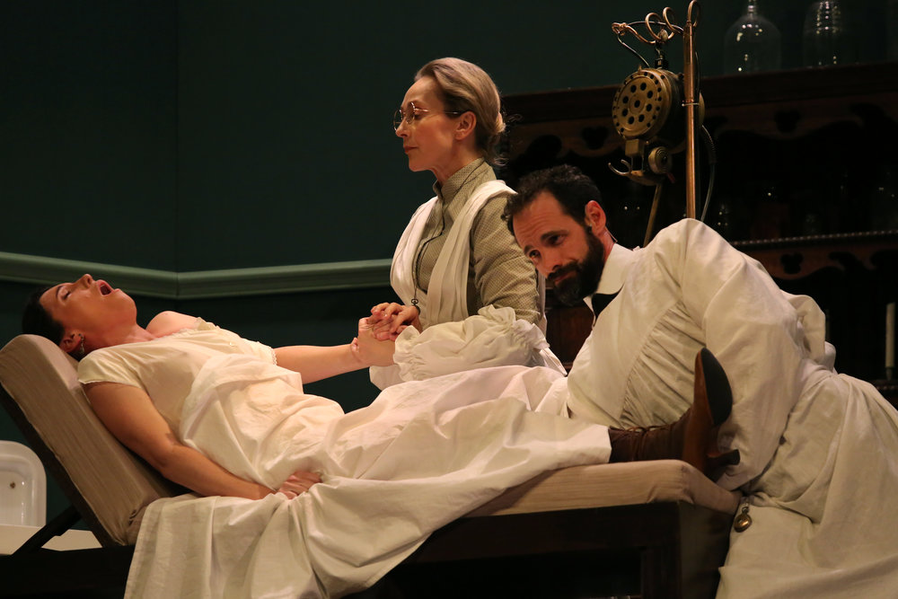 Dr. Givings (Stuart Halusz), assisted ably by Annie (Allison Van Reeken) giving Mrs. Daldry (Jo Morris) medical treatment for 'hysteria'. (Photo Credit: Phillip Gostelow)