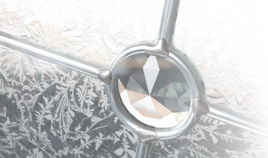 Elegant glazing: Finesse is just one of up to 30 different decorative glass designs available with your Craftsman door. With its linear motifs, organic backing glass and crystal style centre, it is little wonder that it is one of the most popular designs