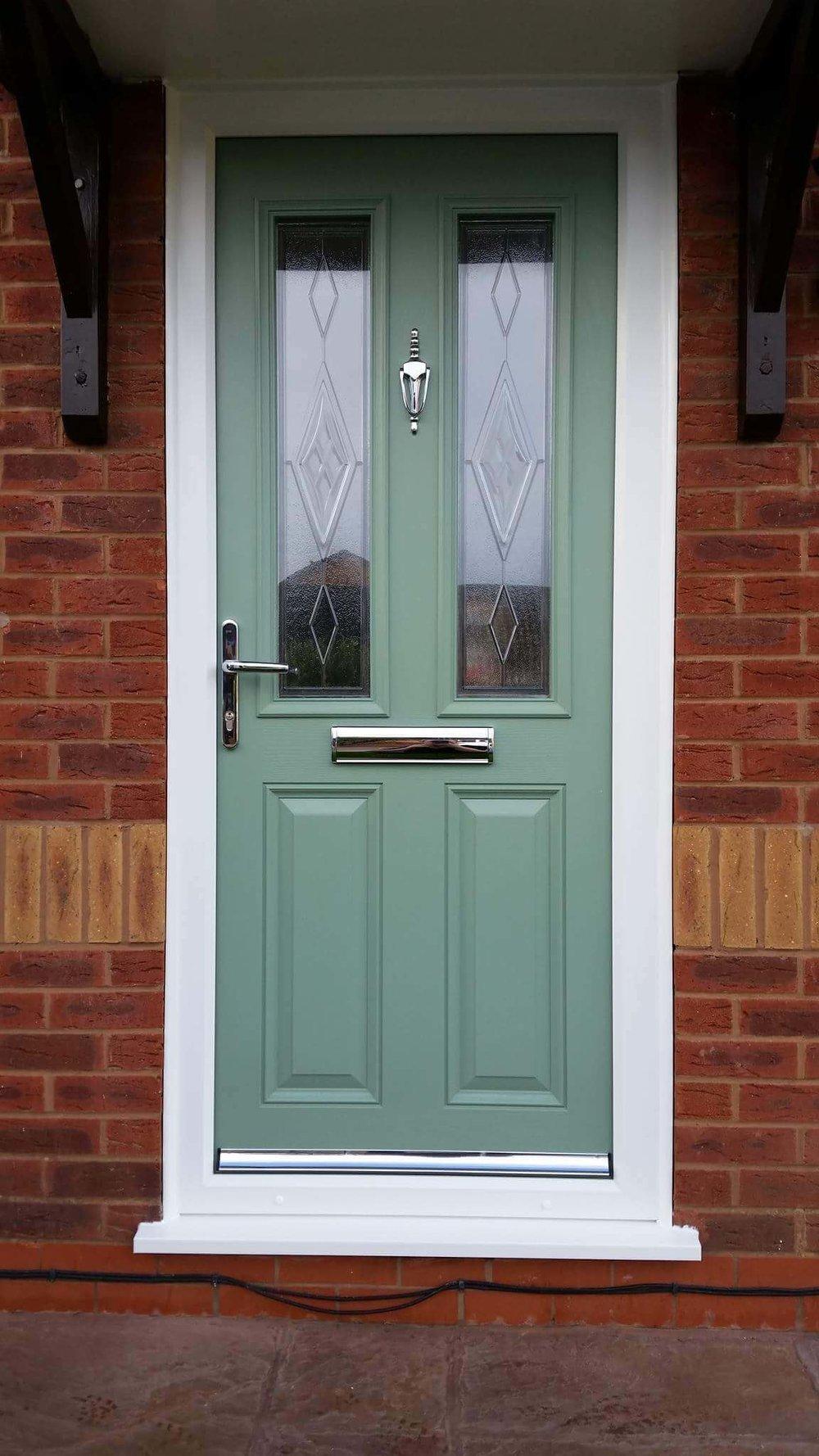 green-composite-door-with-silver-hardware.jpg