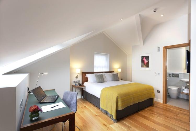 bedroom+&+work+desk+in+loft+style+suite.jpg