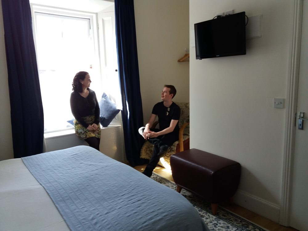 Couple chatting in room.jpg