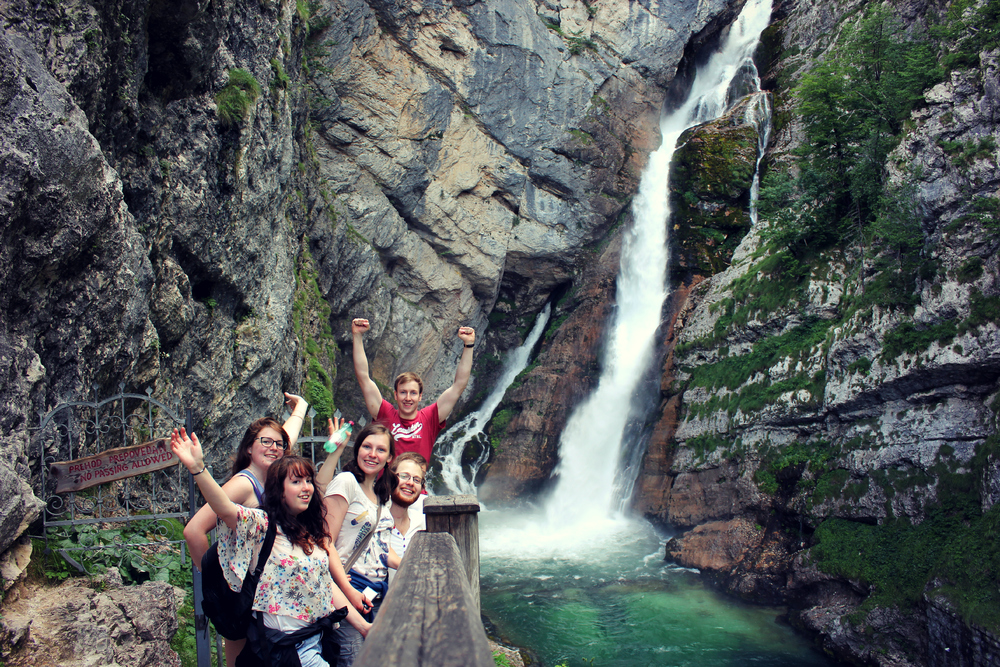Celebrating after a quick hike to this beautiful waterfall in Bohinj