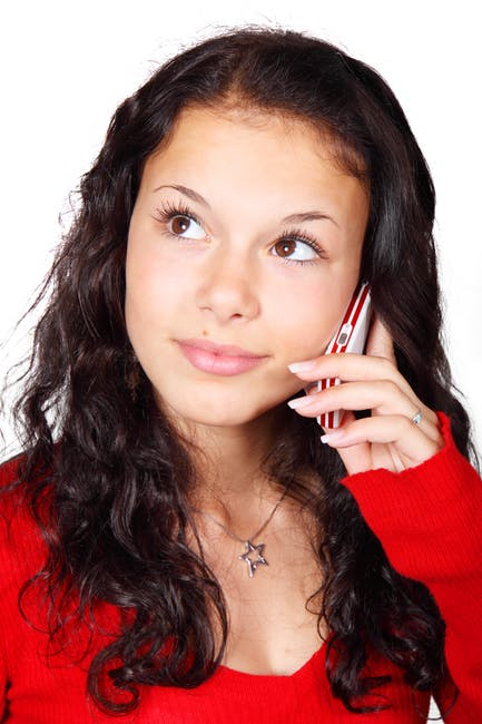 hispanic woman on cell phone.jpg