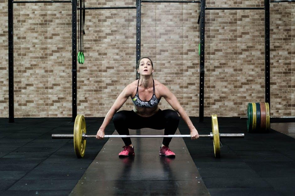 woman lifting weights .jpg