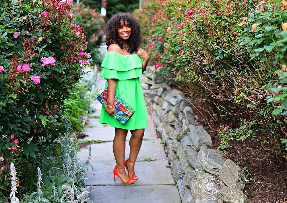 Style & Poise: How to Wear African Prints. Ankara Clutch, Green Ruffle Dress, Orange Sandals, Statement Necklace