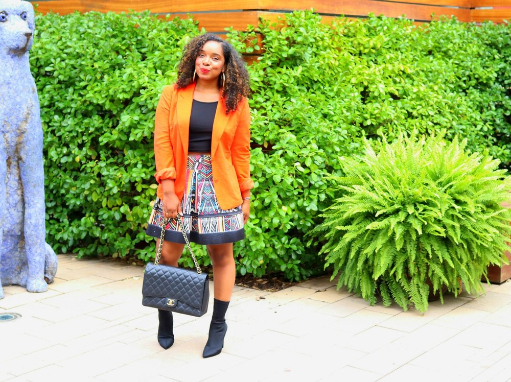 Fall Fashion: Orange Blazer, Fit and Flare Skirt with Sock Boots and Chanel Purse