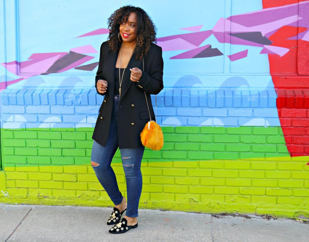 Black blazer with gold buttons, distressed skinnies, mules, faux fur clutch