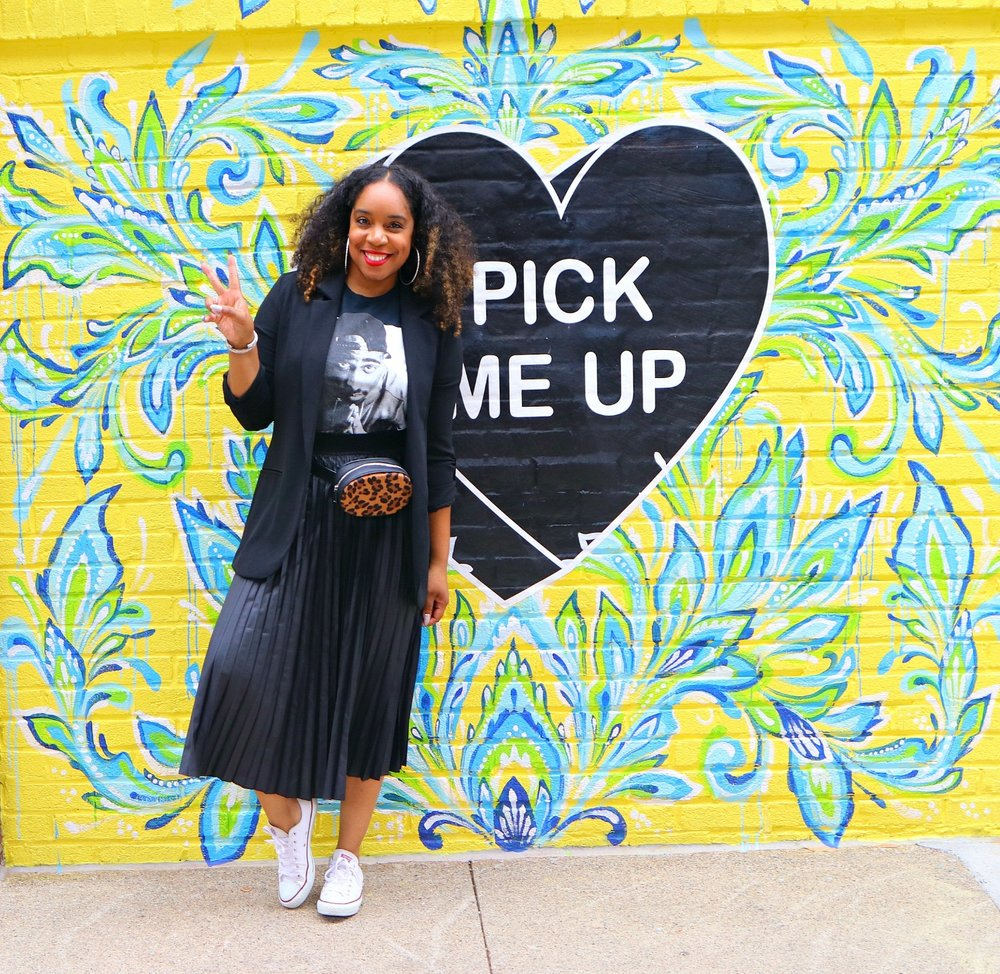 Pleated midi and graphic tee with sneakers