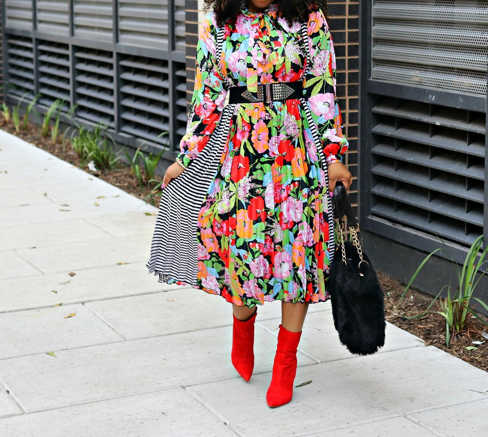 Studded belt, floral and stripe dress, red booties, faux fur purse