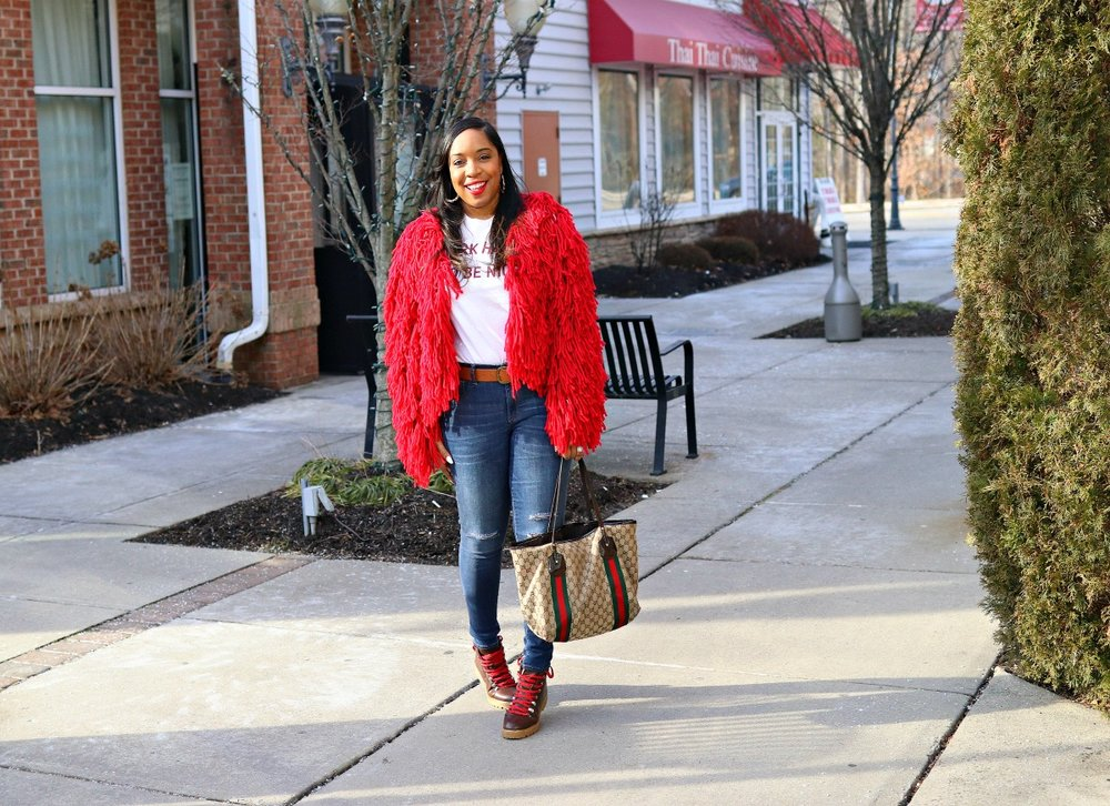 Style & Poise: Red shaggy jacket, graphic tee, distressed denim. Street style