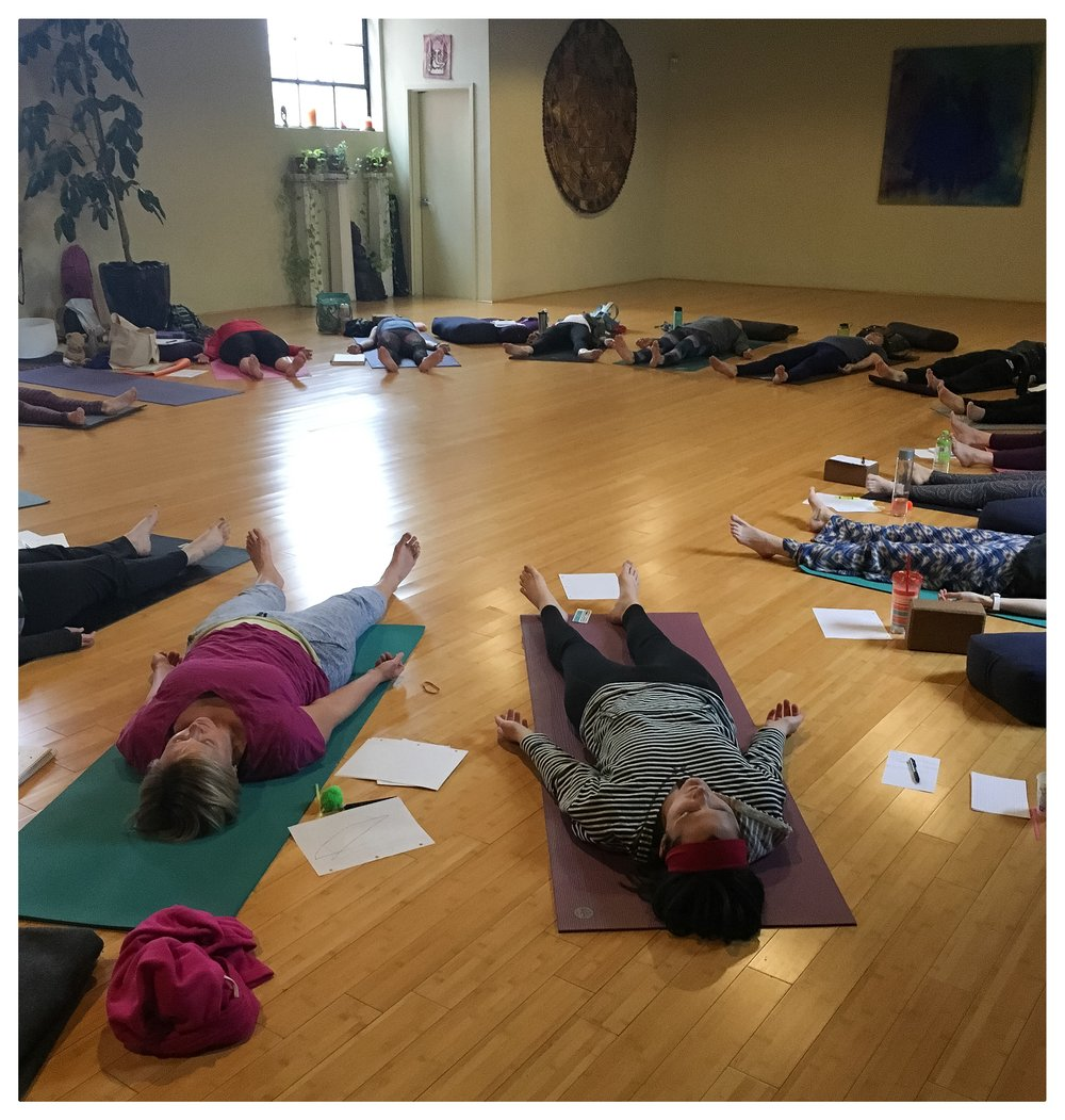 My delightful students pretending to be 7-9 year olds in sweet savasana.