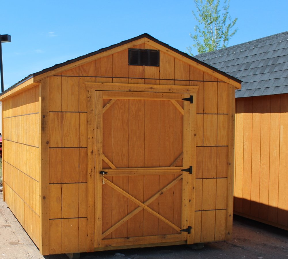 Economy series utility sheds come with one wood door. the building is stained and water sealed with Honey Gold Olympic stain.