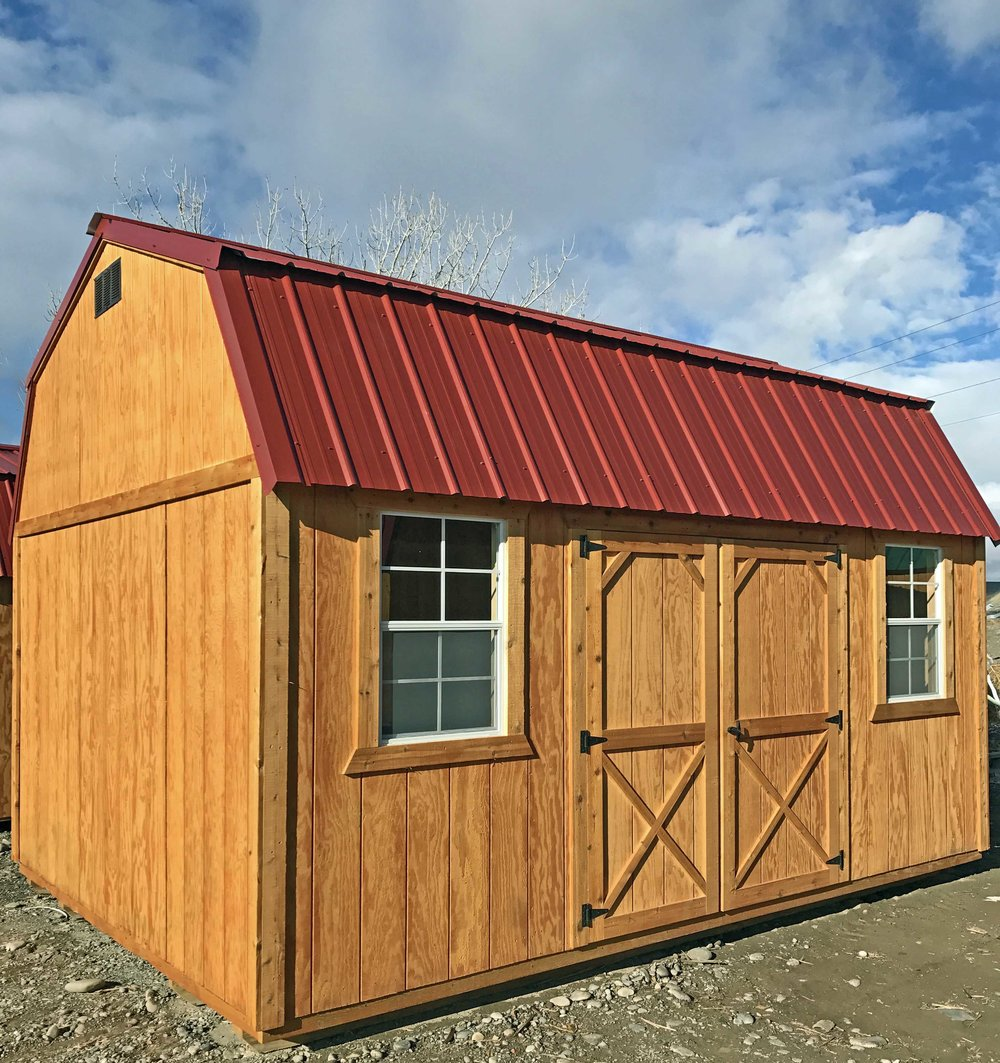 Side Lofted Barn Cabin with beautiful honey gold olympic wood stain. Rustic Red Metal Roof, double wood door (72 inches), two 2x3 windows.