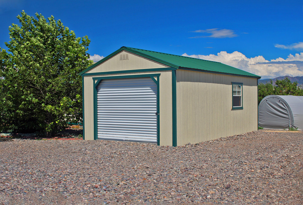 Painted portable garage delivered on gravel.