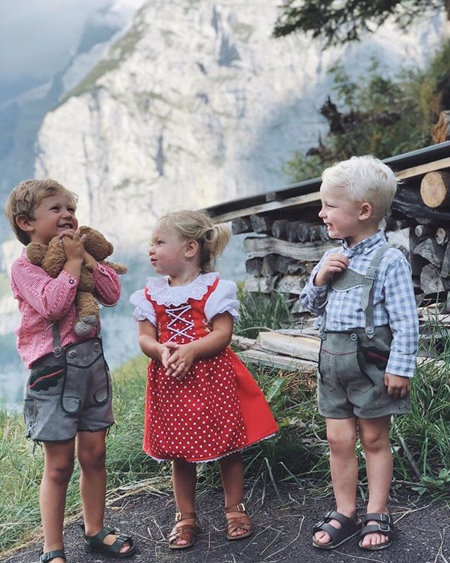 "Here's something I've never told you: the unexpected reason WHY we came to Switzerland 🇨🇭 in the first place. ❤️ Short answer? There's a valley called the lauterbrunnen valley that's my mom's favorite place in the whole world...and she decided to plan a destination 35th anniversary celebration there (aren't Arthur and his cousins' little Swiss celebration outfits adorable??). 🇨🇭 Slightly longer answer? My family visited there several times when we were growing up and my mom fell in love with it. The 70-or-so waterfalls that come into the valley...the layers of mountains upon mountains that you see as you go up the gondola...it totally stole her heart. ⛰ So much so that we actually went there 10 years ago as a family, couldn't see the mountains through the fog the entire time, and my mom said ""let's get out of this hell-hole"" the morning we checked out of our hotel. It's a classic family story now. 😝 I've been praying for months that the weather would stay nice and the mountains would be visible for the celebration...and it was. We watched it rain a little during the dinner while we dipped an assortment of things into cheese fondue but then it cleared up into the most gorgeous, clear sunset. 🌅  My mother was pleased. 🙂 Now, we're jumping the gun by 30 years, but we're trying to decide where our 35th anniversary celebration would be...I have a feeling we haven't quite traveled enough together yet. What about you? Where would you love to have yours?"
