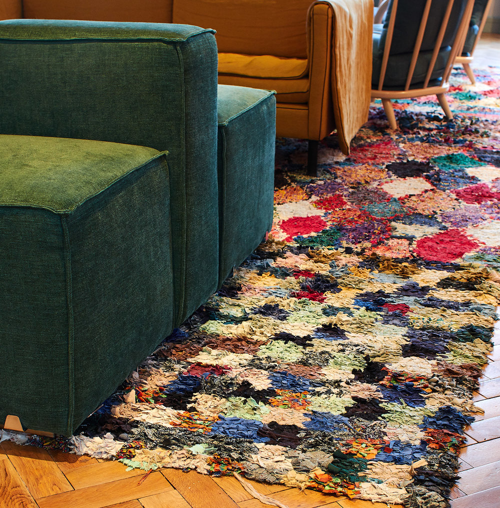 The Conduit Club Rug Installation