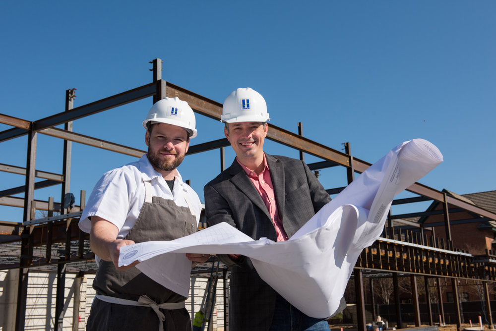 Joe & Justin reviewing construction plans early this year.