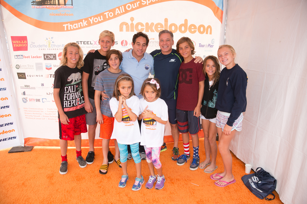 Warren Lichtenstein, his son Stefan, SKECHERS President Michael Greenberg and friends and family at the 2015 SKECHERS Pier to Pier Friendship Walk.