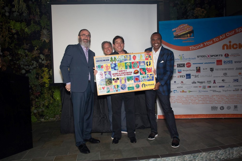 Rabbi Yossi Mintz, Michael Greenberg, president of Skechers, and legendary boxer Sugar Ray Leonard presented Warren Lichtenstein with an plaque for Steel Sport's and Steel Partners Foundation's support of the 2015 Skechers Pier to Pier Friendship Walk.