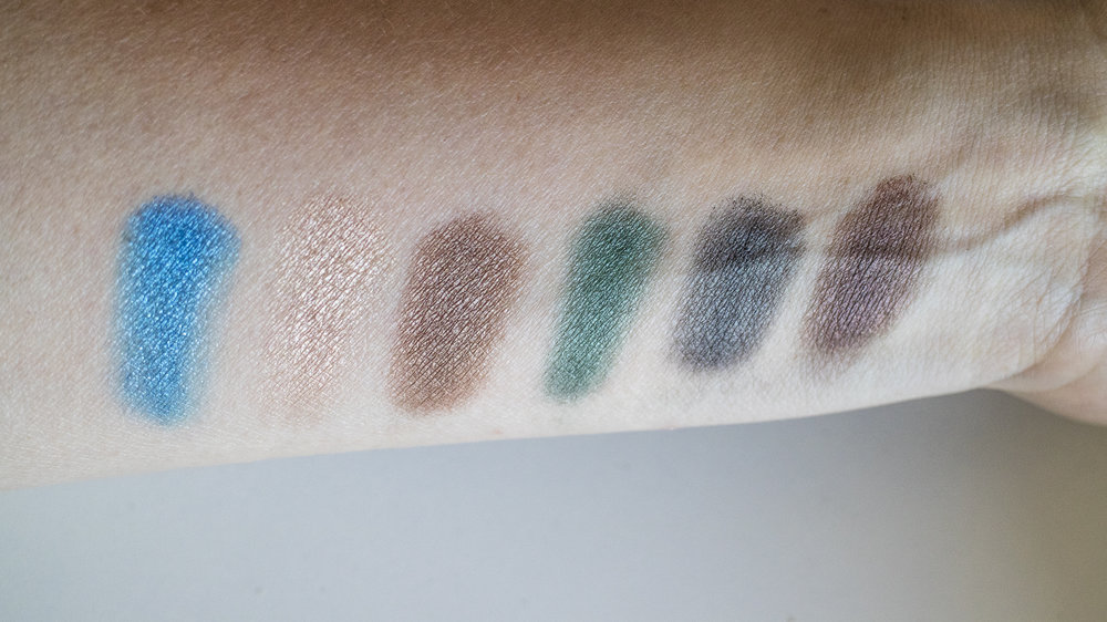 Brush swatches over eye primer - from left: Fired Sapphire, Blonde Cumin, Metal Saffron, Burnished Sage, Grey Amber, Black Nutmeg