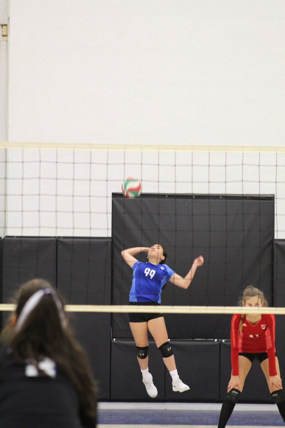 14 Blue jump float serve.jpeg