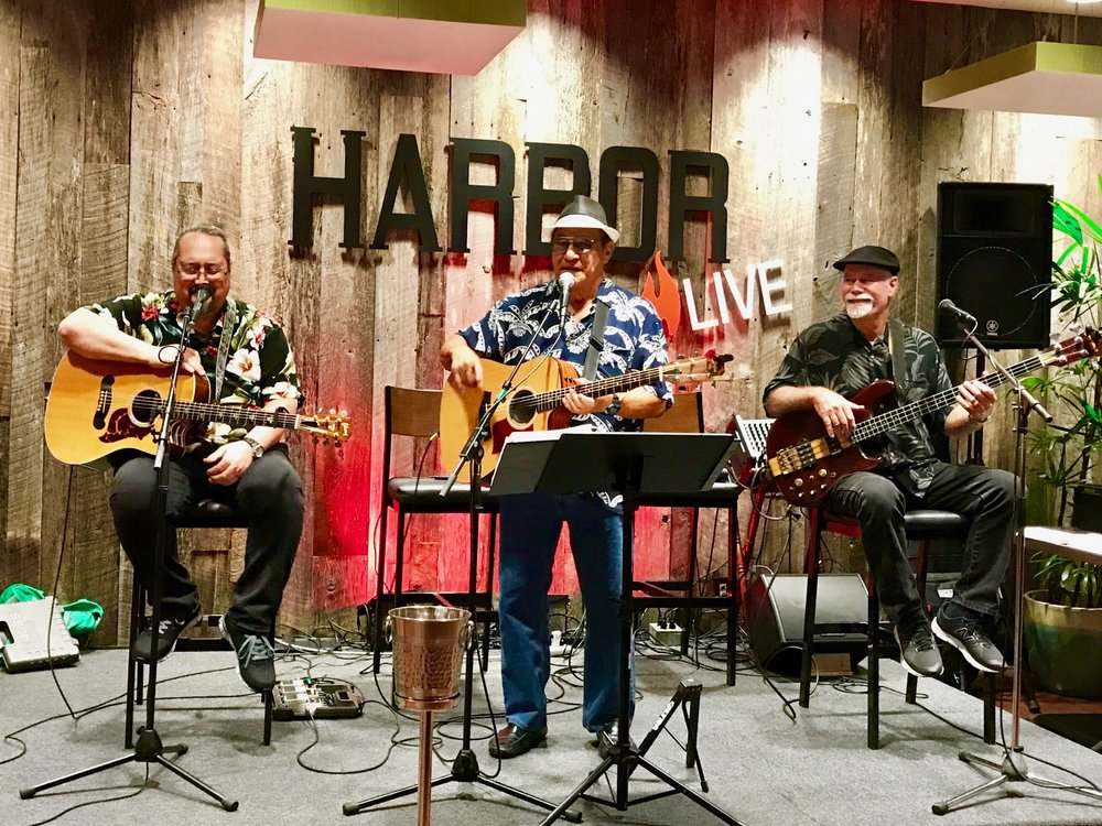 PETER APO BAND   presents conversation friendly music inclusive of Hawaiian, folk, pop standards, blues, and light rock. Singer-songwriter- recording artist Peter Apo is joined by accomplished bassist and vocalist Jim Christian and stellar guitarist, performer, and songwriter Gordon Freitas.