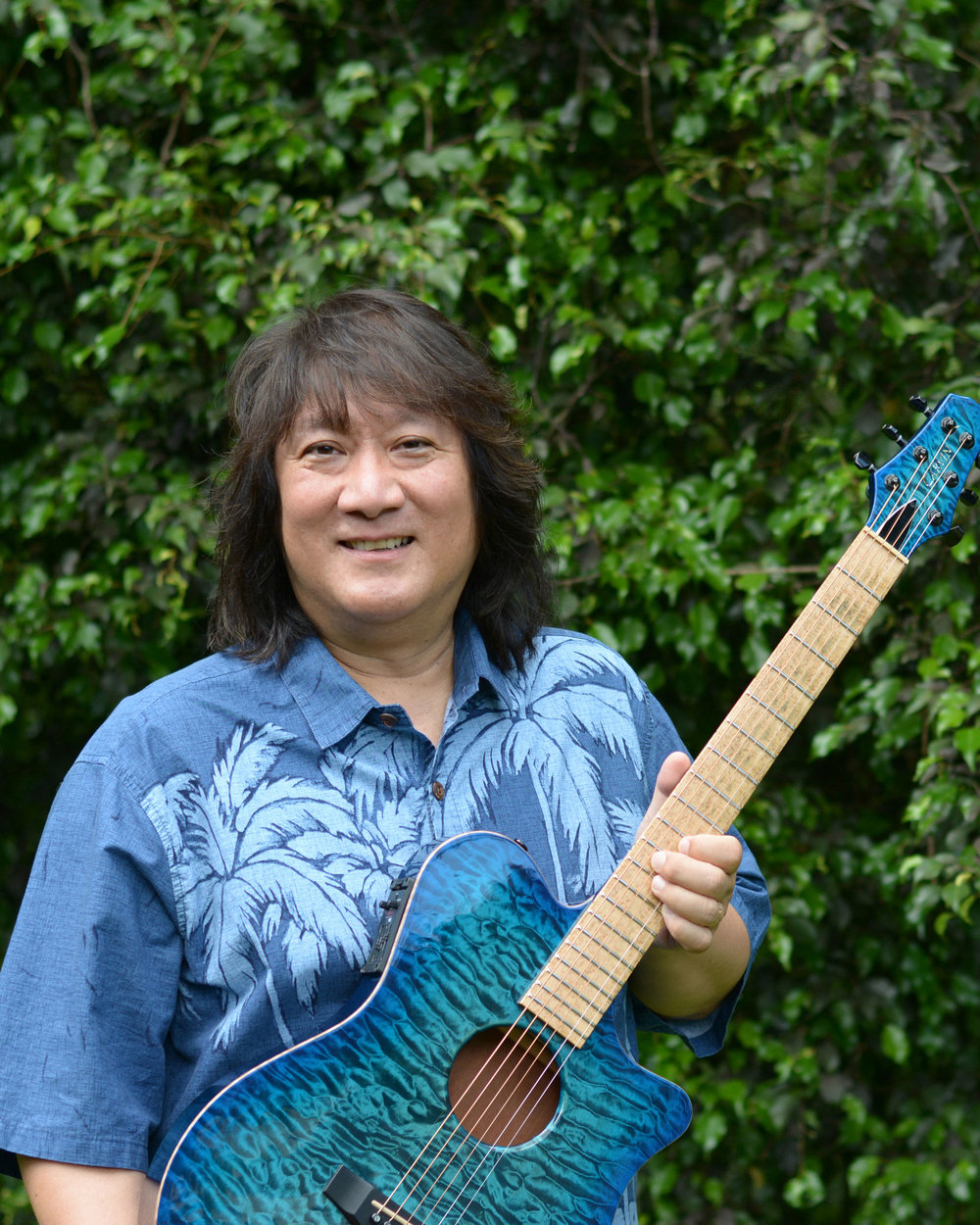 "Harry Koizumi, also known as ""Uncle"" Harry, was born and raised in Honolulu, Hawaii. He studied classical guitar at the University of Hawaii and sang in the UH Choir and with the Chamber Singers. Since 1985, Harry has shared his love of music by teaching guitar and ukulele at Kailua's Coconut Grove Music Store.  In 1991 Harry became very interested in Hawaiian music and began studying with slack-key guitar master, Raymond Kane. In 1993, Harry was awarded an apprenticeship with Mr. Kane by the Hawaii State Foundation of Culture and the Arts to perpetuate the Hawaiian slack-key guitar. Harry then studied Hawaiian steel guitar with Jerry Byrd for three years."