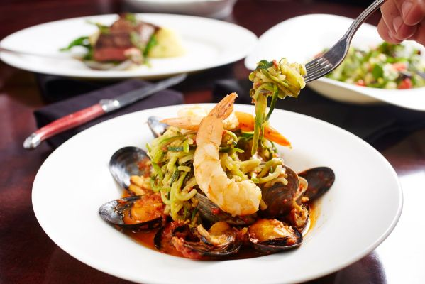 Shrimp, clams and mussels join zucchini linguine at LB Social in Long Beach. (Credit: Yvonne Albinowski)