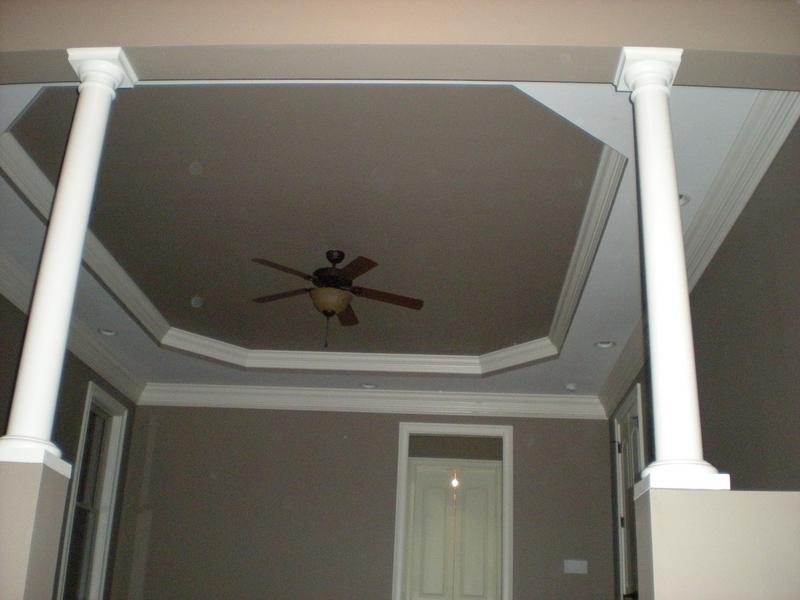 Interior painting of large master bedroom with ceilings to match accent walls.