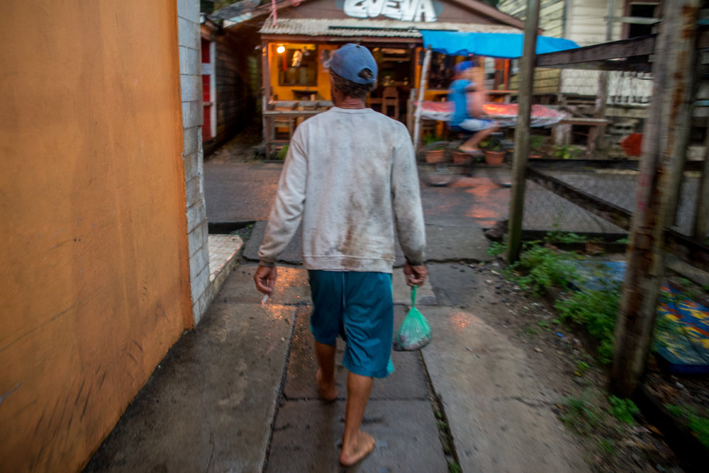 Sorro doesn't own a pair of shoes and he has no intention of buying any. He trots along the alleyways and wet streets of Utila with his plastic bag full of tuna fillets. He's well known around town. The restaurant cooks and owners know him well, so making a sale is generally uncomplicated.