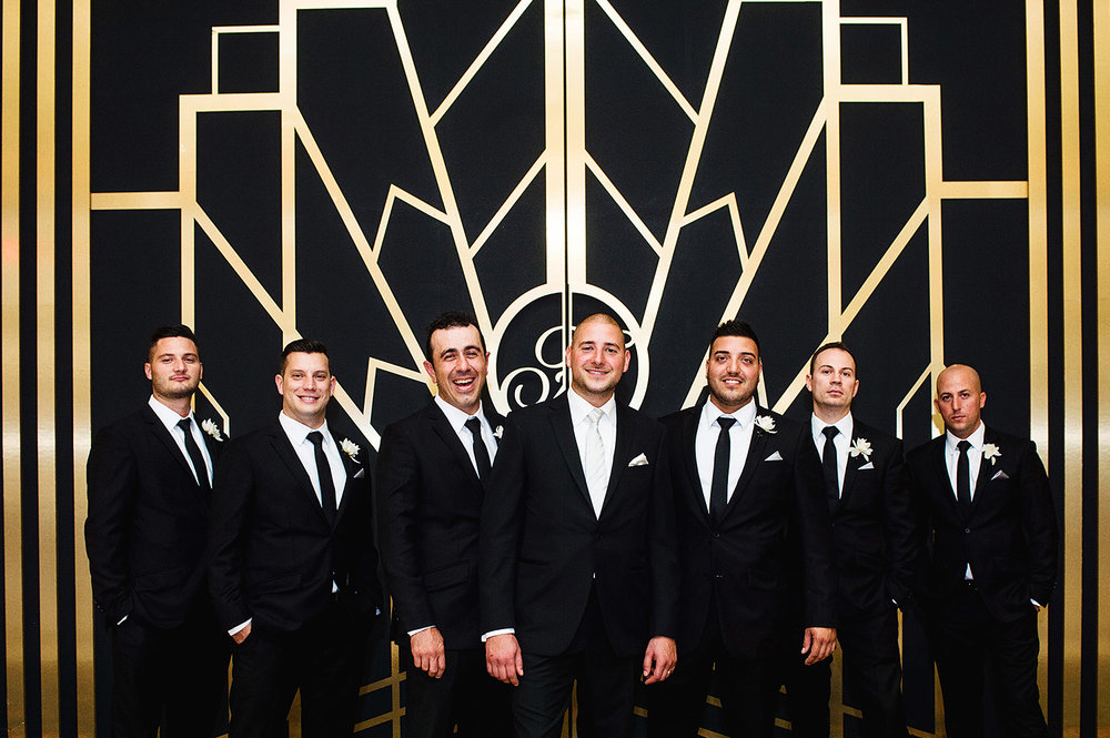 groomsmen-fairmont-hotel-vancouver-art-deco-wall-vancouver-wedding-yaletown-photography-photo