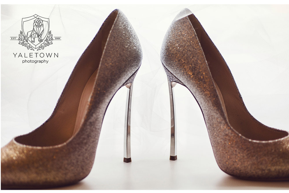 Any one who can manage wearing 5 inch high heels on their wedding day garners my respect!  Apparently these gorgeous gems were comfortable shoes so long as you weren't standing in them for long periods of time:)