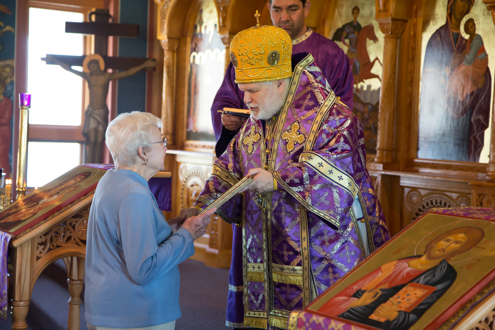 Olga Sears receives a gramota for over 50 years of service as the church historian.