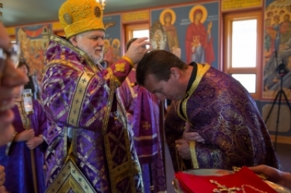 Bishop Paul Presents Archpriest Fr. Dusan with Jeweled Cross. -