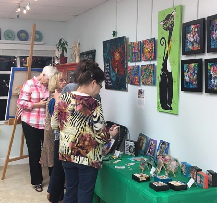 TRAX Art Gallery Open House guests buying original artworks!