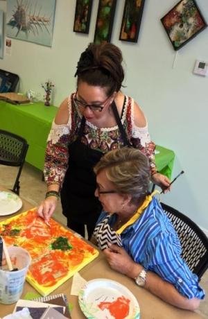 Tatiana Cast assisting a student.