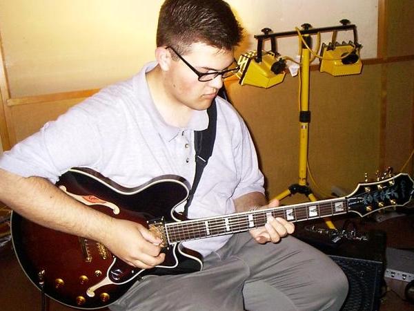 John_holding_guitar.jpg