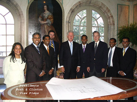 Presidents Bill Clinton and George Bush view plans for SLMANA Project.