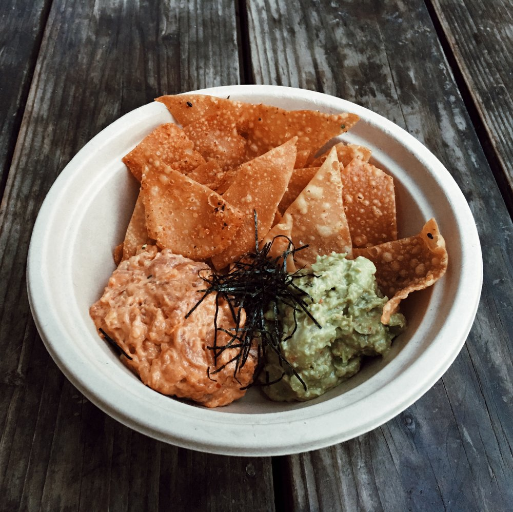 Poke Crunch with our Spicy Tuna Tartare, Edamame Guac and housemade wonton chips.