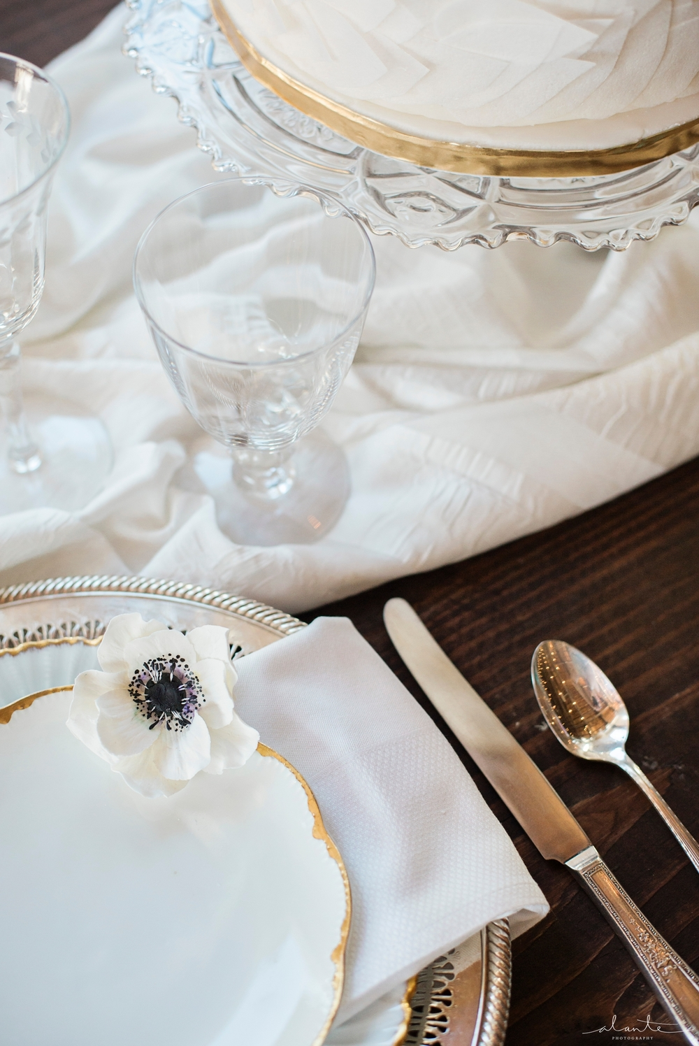 www.alantephotography.com | White and gold vintage placesetting with sugar anemone | Alante Photography