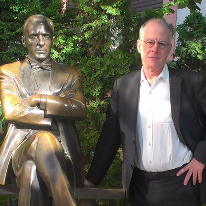 Photo of Paul Berman and bronze statue