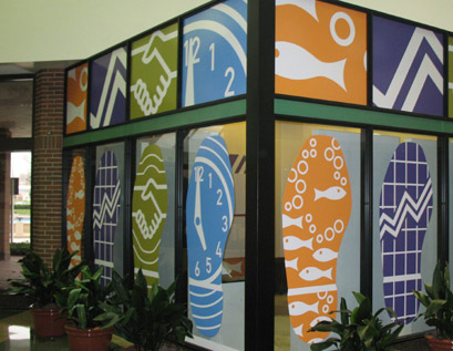On this project the art panels are cut to fit into glass conference room windows.  The top windows are completely covered while the bottom window graphic panels have been cut into shoe shapes to allow some visibility.