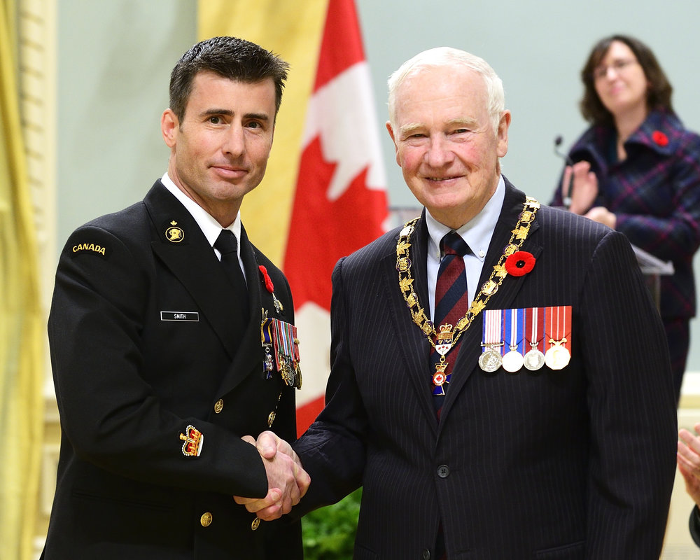 "Member of the Order of Military Merit, here with the Governor General of Canada, the Honourable David Johnston. The Order is awarded to no more than 1/10th of 1  % of  the Canadian Armed Forces each year. It is invested on behalf of the Queen as a culmination of a remarkable career of service to Canada.  ""To those who have been appointed and promoted to the Order, I commend you for your professional and dedicated service. Your membership in a society of merit recognizes the best qualities of military profession and makes you models that all others would do to emulate."" Her Majesty Queen Elizabeth II."