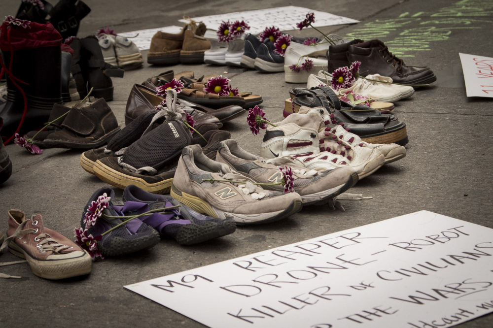 "Oct. 6, 2012: The ""World Can't Wait"" protest group hold a memorial of shoes for the civilians killed in the Iraq and Afghanistan wars in Times Square."