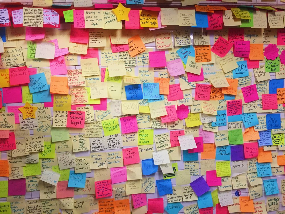 November 2016: New Yorkers write post-it notes of encouragement at Union Square station following the election of Donald Trump.