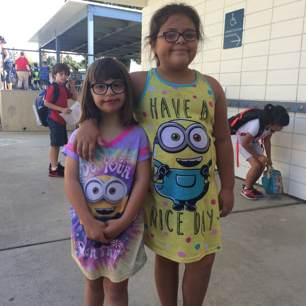 Macyn with her sweet friend Maya, at school, on pajama day.