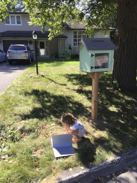 Our daughter is a faithful fan of our Little Free Library!