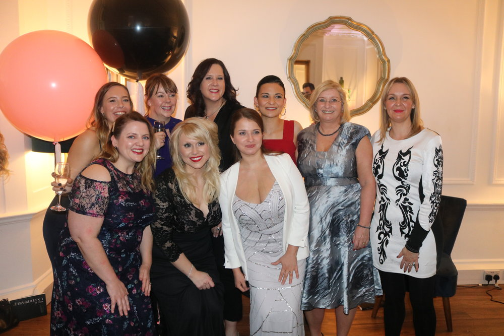 A lovely group photo of the She is Unstoppable International Best Selling Authors